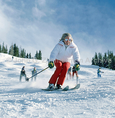 Ethel Kennedy skis down Aspen's Buckhorn slope with her kids following close behind, Aspen Colorado, December 1978. Photo by John G. Zimmerman