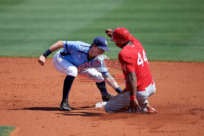 Charlotte Stone Crabs shortstop Jake Cronenworth (2) tags Austin Wilson (44) at second base during a game against the Palm Beach Cardinals on April 12, 2017 at Charlotte Sports Park in Port Charlotte, Florida.  Palm Beach defeated Charlotte 8-7.  (Mike Janes/Four Seam Images)