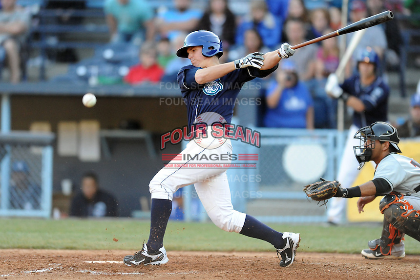 Asheville Tourists catcher Ryan Casteel #7 swings at a pitch  during a game between the Delmarva Shorebirds and the Asheville Tourists at McCormick Field, Asheville, North Carolina April 7, 2012. The Tourists won game one of a double header  8-4  (Tony Farlow/Four Seam Images)..