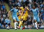 Wilfried Zaha of Crystal Palace in action with Raheem Sterling of Manchester City during the English Premier League match at the Etihad Stadium, Manchester. Picture date: May 6th 2017. Pic credit should read: Simon Bellis/Sportimage