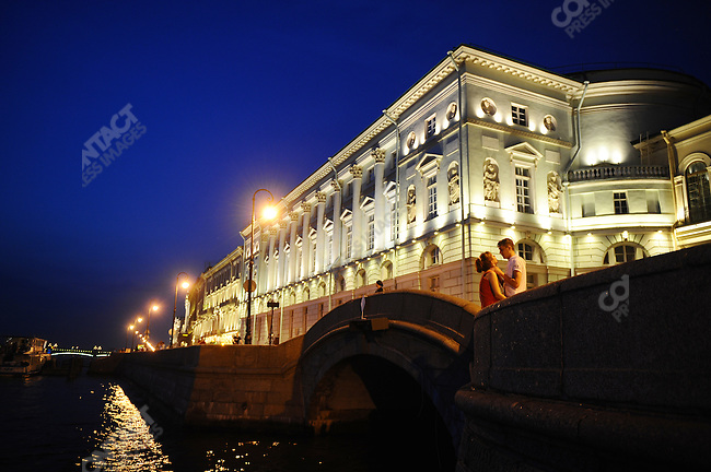 A couple shared an intimate moment in the hours after midnight, during White Nights, on the banks of the river Neva, St. Petersburg, Russia, July 8, 2010