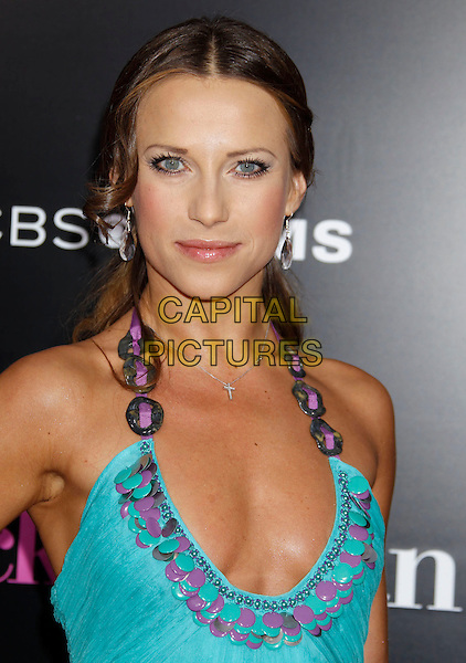 "EDYTA SLIWINSKA.""The Back-up Plan"" Los Angeles Premiere held at the Regency Village Theatre, Westwood, California, USA, 21st April 2010. .arrivals headshot portrait turquoise halterneck purple smiling chain weave cleavage low cut neckline .CAP/ADM/MJ.©Michael Jade/AdMedia/Capital Pictures."