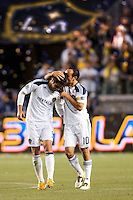 Landon Donovan (10) kisses team mate Juan Pablo Angel (9) after assisting Landon on his second goal of the game. The LA Galaxy defeated the Portland Timbers 3-0 at Home Depot Center stadium in Carson, California on  April  23, 2011....