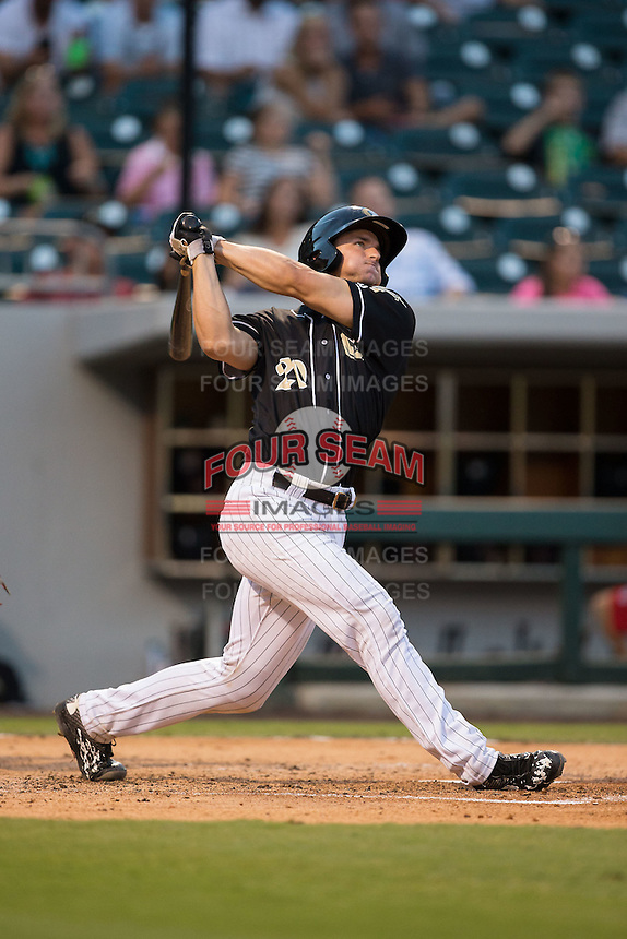Rob Brantly (20) of the Charlotte Knights follows through on his swing against the Gwinnett Braves at BB&T BallPark on August 11, 2015 in Charlotte, North Carolina.  The Knights defeated the Braves 3-2.  (Brian Westerholt/Four Seam Images)