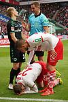 01.12.2018, RheinEnergieStadion, Koeln, GER, 2. FBL, 1.FC Koeln vs. SpVgg Greuther Fürth,<br />  <br /> DFL regulations prohibit any use of photographs as image sequences and/or quasi-video<br /> <br /> im Bild / picture shows: <br /> Jannes Horn (FC Koeln #23),    verletzt am Boden foul durch Maximilian Sauer (Fuerth #24), Schiedsrichter / referee Sören Storks (SR) ermahnt ihn<br /> <br /> Foto © nordphoto / Meuter