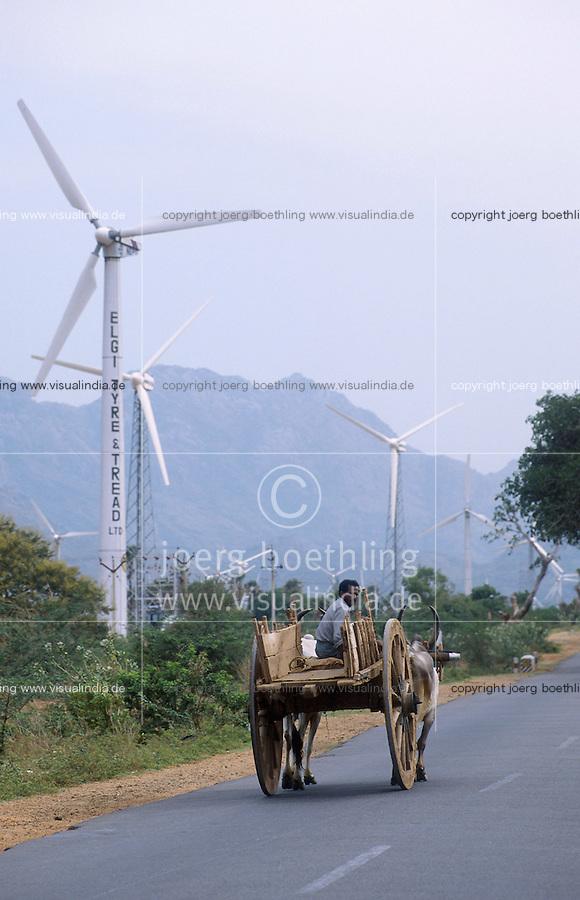 INDIA Tamil Nadu Cape Comorin, contrast modern between traditional, farmer with bullock cart and site for wind turbines / INDIEN Kap Komorin, Farmer mit Ochsenkarren vor Windpark