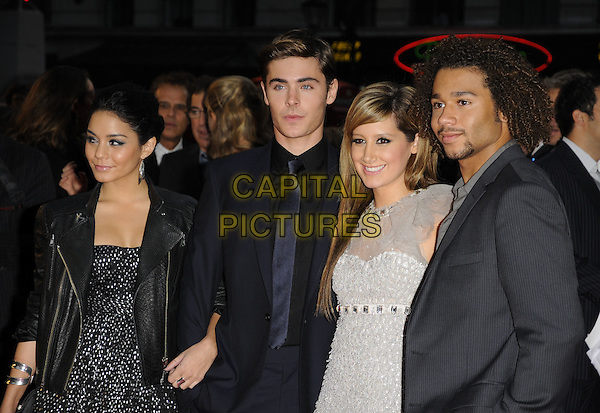 "VANESSA ANNE HUDGENS, ZAC EFRON, ASHLEY TISDALE & CORBIN BLEU.The UK Film Premiere of ""High School Musical 3: Senior Year"" at the Empire Leicester Square in London, England, UK. .October 7th 2008.half length black leather biker jacket cast couple silver suit tie dress white print grey gray sheer .CAP/CAN.©Can Nguyen/Capital Pictures."
