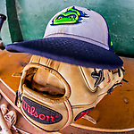 4 September 2017: A Vermont Lake Monsters Cap and Glove lie ready in the dugout prior to the first game of a double-header against the Tri-City ValleyCats at Centennial Field in Burlington, Vermont. The teams split their day, with Tri-City winning 6-5 in the first game, and the Lake Monsters taking the second 7-4 in NY Penn League action. Mandatory Credit: Ed Wolfstein Photo *** RAW (NEF) Image File Available ***