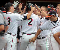 Teammates celebrate Virginia infielder John La Prise (2) after scoring in the 3rd inning during the game against Bucknell Friday at Davenport Field in Charlottesville, VA. Photo/The Daily Progress/Andrew Shurtleff