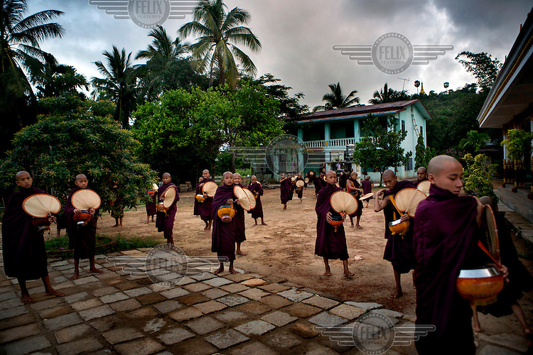 Monks from the Myazeda Man Oo Monastery, where they produce promotional material and literature for the Buddhist nationalist 969 movement, prepare to go on their rounds to collect morning alms in Mawlamyine, Mon State. /Felix Features