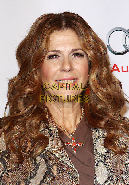 RITA WILSON .Annual Backstage At The Geffen Gala -Arrivals held at The Geffen Playhouse, Westwood, California, USA, .22nd March 2010..portrait headshot brown beige snakeskin snake cross necklace smiling .CAP/ADM/TC.©T. Conrad/AdMedia/Capital Pictures.