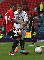 Men's Olympic Football match Egypt v Belarus on 1.8.12...Hassan Hossam of Egypt and Denis Polyakov of Belarus, during the Men's Olympic Football match between Egypt v Belarus at Hampden Park, Glasgow.