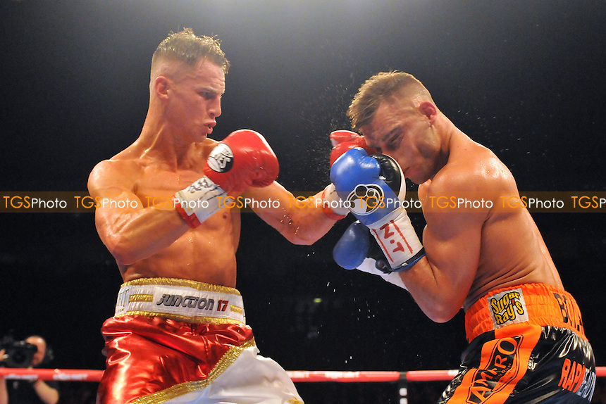 Tommy Martin (red/white shorts) defeats Ricky Boylan - Boxing at the O2 Arena, London, promoted by Matchroom Sports - 31/01/15 - MANDATORY CREDIT: Philip Sharkey/TGSPHOTO - Self billing applies where appropriate - contact@tgsphoto.co.uk - NO UNPAID USE