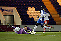 Joel Byrom of Stevenage sees his shot beat Ben Williams of Colchester for their sixth goal. - Colchester United v Stevenage - Weston Homes Community Stadium, Colchester - 26th December 2011  .© Kevin Coleman 2011