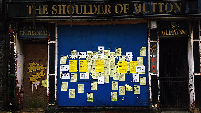 Pictured: Art on the outside disused pub The Shoulder of Mutton, High Street, Swansea. Saturday 15 July 2017<br />Re: The Troublemakers Festival, on the High Street, Swansea, south Wales, UK.