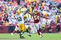 Landover, MD - September 23, 2018: Green Bay Packers quarterback Aaron Rodgers (12) gets the pass off just over the hand of Washington Redskins linebacker Mason Foster (54) during game between the Green Bay Packers and the Washington Redskins at FedEx Field in Landover, MD. The Redskins get the win 31-17 over the visiting Packers. (Photo by Phillip Peters/Media Images International)