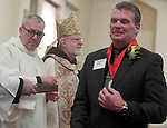 MALDEN MA NOVEMBER25: David Moran of of Saint Agnes Parish in Arlington, clearly moved after receiving his award that hangs from his neck from Cardinal Sean O'Malley during 2018 Cheverus awards, Moran was one of 125 recipients, Sunday, November 25, 2018, at the Immaculate Conception Church in Malden. (Herald Photo by Jim Michaud)