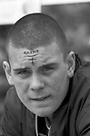 Skinhead 1980s UK, London boy with 'Skins' tattooed along with a cross to his forehead 1984 England