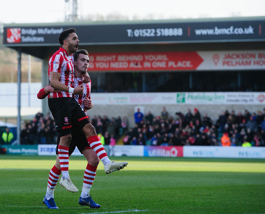 Lincoln City's Bruno Andrade, left, celebrates scoring the opening goal with team-mate Harry Toffolo<br /> <br /> Photographer Chris Vaughan/CameraSport<br /> <br /> The EFL Sky Bet League Two - Lincoln City v Northampton Town - Saturday 9th February 2019 - Sincil Bank - Lincoln<br /> <br /> World Copyright © 2019 CameraSport. All rights reserved. 43 Linden Ave. Countesthorpe. Leicester. England. LE8 5PG - Tel: +44 (0) 116 277 4147 - admin@camerasport.com - www.camerasport.com