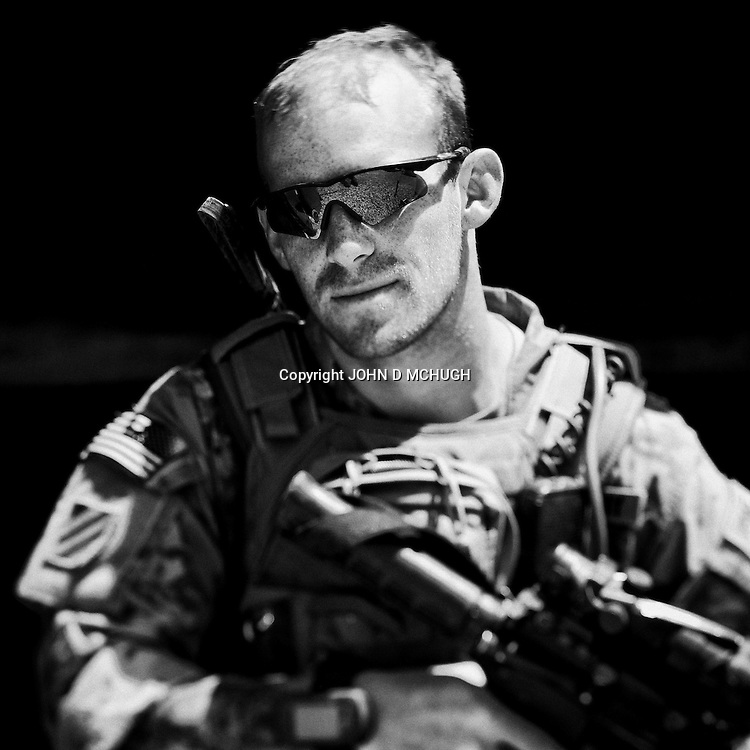 SSG Knight from 1 Platoon, Delta Co, 1-66, 4th Infantry Division, is seen at Combat Outpost TJ in the Arghandab Valley, Kandahar, 03 May 2011. (John D McHugh)