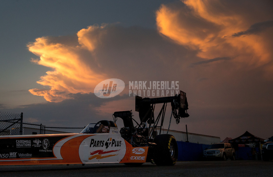 Aug. 30, 2013; Clermont, IN, USA: The car of NHRA top fuel dragster driver Clay Millican is towed back to the pits as the sun sets during qualifying for the US Nationals at Lucas Oil Raceway. Mandatory Credit: Mark J. Rebilas-