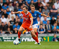 Shrewsbury Town's Shaun Whalley (left) under pressure from Portsmouth's Lee Brown (right) <br /> <br /> Photographer David Horton/CameraSport<br /> <br /> The EFL Sky Bet League One - Portsmouth v Shrewsbury Town - Saturday September 8th 2018 - Fratton Park - Portsmouth<br /> <br /> World Copyright &copy; 2018 CameraSport. All rights reserved. 43 Linden Ave. Countesthorpe. Leicester. England. LE8 5PG - Tel: +44 (0) 116 277 4147 - admin@camerasport.com - www.camerasport.com