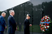 Cindy McCain, wife of, Sen. John McCain, R-Ariz., accompanied by President Donald Trump's Chief of Staff John Kelly, left, and  Defense Secretary Jim Mattis, second from left, lays a wreath at the Vietnam Veterans Memorial in Washington, Saturday, Sept. 1, 2018, during a funeral procession to carry the casket of her husband from the U.S. Capitol to National Cathedral for a Memorial Service. McCain served as a Navy pilot during the Vietnam War and was a prisoner of war for more than five years. <br /> Credit: Andrew Harnik / Pool via CNP