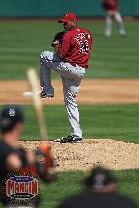 SCOTTSDALE - MARCH 6:  Edwin Jackson of the Arizona Diamondbacks pitches during a spring training game against the San Francisco Giants on March 6, 2010 at Scottsdale Stadium in Scottsdale, Arizona. (Photo by Brad Mangin)