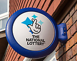 Wall mounted sign for the National Lottery, Amesbury, Wiltshire, England, UK