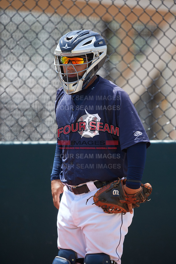 GCL Tigers East catcher Jheyser Azuaje (12) warms up a pitcher in the bullpen during a game against the GCL Tigers West on August 8, 2018 at Tigertown in Lakeland, Florida.  GCL Tigers East defeated GCL Tigers West 3-1.  (Mike Janes/Four Seam Images)