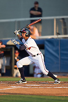 Derian Cruz (4) of the Danville Braves follows through on his swing against the Pulaski Yankees at American Legion Post 325 Field on August 1, 2016 in Danville, Virginia.  The Yankees defeated the Braves 4-1.  (Brian Westerholt/Four Seam Images)