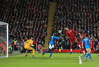 27th November 2019; Anfield, Liverpool, Merseyside, England; UEFA Champions League Football, Liverpool versus SSC Napoli ; Virgil van Dijk of Liverpool narrowly fails to connect with a header in the six yard area - Editorial Use