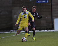 Joseph Cardle tackles Jason Naismith in the Ross County v St Mirren Scottish Professional Football League match played at the Global Energy Stadium, Dingwall on 17.1.15.