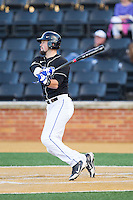 Jordan Betts (41) of the Duke Blue Devils follows through on his swing against the Wake Forest Demon Deacons at Wake Forest Baseball Park on April 25, 2014 in Winston-Salem, North Carolina.  The Blue Devils defeated the Demon Deacons 5-2.  (Brian Westerholt/Four Seam Images)