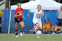 2 October 2011:  FIU midfielder/forward Nicole DiPerna (16) moves the ball upfield while being pursued by South Alabama defender Jacey Chandler (17) in the second half as the FIU Golden Panthers defeated the University of South Alabama Jaguars, 2-0, at University Park Stadium in Miami, Florida.