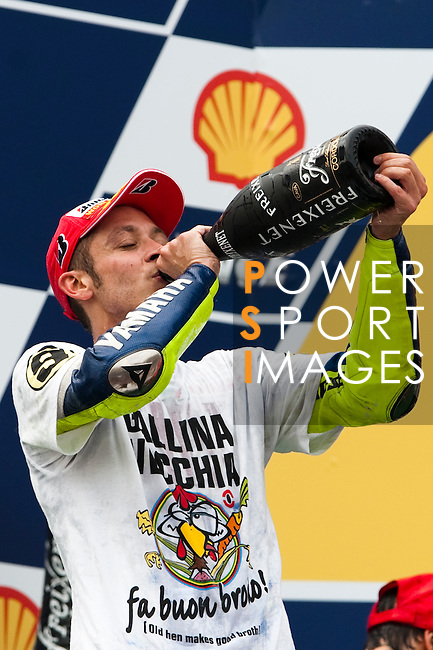 KUALA LUMPUR, MALAYSIA - OCTOBER 25:  Fiat Yamaha Team rider Valentino Rossi of Italy drinks champagne as he celebrates after winning his ninth MotoGP World Championship title with his third place in the Malaysian MotoGP, which is round 16 of the MotoGP World Championship at the Sepang Circuit on October 25, 2009 in Kuala Lumpur, Malaysia. Photo by Victor Fraile / The Power of Sport Images