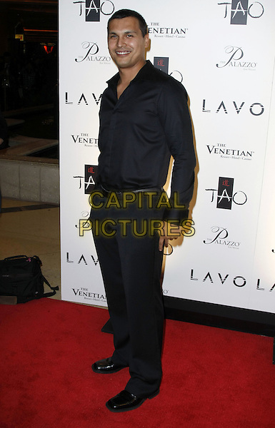 ADAM BEACH .New Year's Eve Celebrations at Lavo and TAO Nightclubs inside the Palazzo and Venetian Resort Hotel and Casino, Las Vegas, Nevada, USA, 31st December 2008..New Year's eve party  full length trousers black shirt smiling .CAP/ADM/MJT.©MJT/Admedia/Capital Pictures
