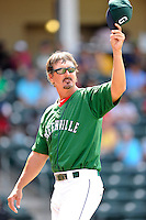 Pitching coach Paul Abbott (48) of the Greenville Drive signals to the bullpen in a game against the Asheville Tourists on Sunday, July 20, 2014, at Fluor Field at the West End in Greenville, South Carolina. Asheville won game one of a doubleheader, 3-1. (Tom Priddy/Four Seam Images)