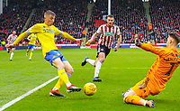 Leeds United's Jack Clarke plays the ball past Sheffield United's Dean Henderson to Pablo Hernandez, who slotted the winner<br /> <br /> Photographer Alex Dodd/CameraSport<br /> <br /> The EFL Sky Bet Championship - Sheffield United v Leeds United - Saturday 1st December 2018 - Bramall Lane - Sheffield<br /> <br /> World Copyright © 2018 CameraSport. All rights reserved. 43 Linden Ave. Countesthorpe. Leicester. England. LE8 5PG - Tel: +44 (0) 116 277 4147 - admin@camerasport.com - www.camerasport.com