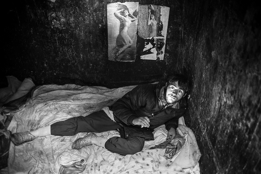 Remus, 26, says that he prefers to live alone rather than in the crowded underground canal near Gara de Nord. His living quarters are a room just big enough for him to lie across, near the city's heating system, so it stays warm in the winter.