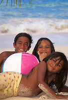 Happy Hawaiian children playing at Waimanalo beach