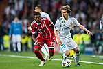 Luka Modric (R) of Real Madrid fights for the ball with David Alaba of FC Bayern Munich during the UEFA Champions League Semi-final 2nd leg match between Real Madrid and Bayern Munich at the Estadio Santiago Bernabeu on May 01 2018 in Madrid, Spain. Photo by Diego Souto / Power Sport Images