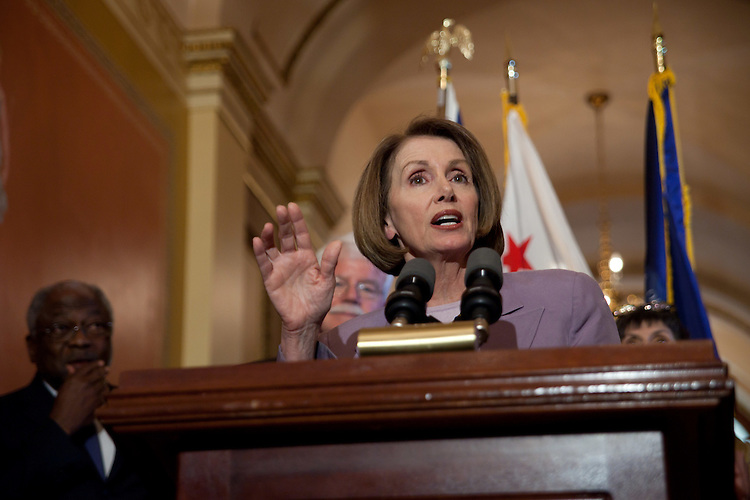 WASHINGTON, DC - May 4: Speaker of the House Nancy Pelosi (D-Calif.) addresses reporters after a three hour meeting with prominent economists Tuesday.  In the background is House whip Rep. James E. Clyburn (D-S.C.), left, Chairman of the House Education and Labor Committee, Rep. George Miller (D-Calif.), center, and Rep. Rosa DeLauro (D-Conn.). (Photo by Ryan Kelly/Congressional Quarterly)