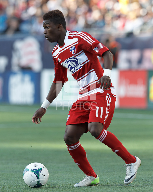 FC Dallas defender Fabian Castillo (11) looks to pass..  In a Major League Soccer (MLS) match, FC Dallas (red) defeated the New England Revolution (blue), 1-0, at Gillette Stadium on March 30, 2013.