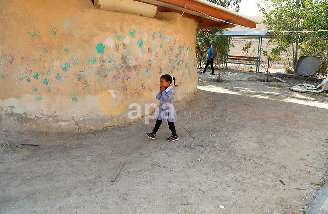 Palestinian Bedouins school walk at her school on the first day of a new school year, in al-Khan al-Ahmar village near the West Bank city of Jericho August 23, 2017. Photo by Shadi Hatem