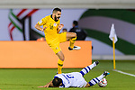 Aziz Behich of Australia (top) fights for the ball with Davronbek Khashimov of Uzbekistan (bottom) during the AFC Asian Cup UAE 2019 Round of 16 match between Australia (AUS) and Uzbekistan (UZB) at Khalifa Bin Zayed Stadium on 21 January 2019 in Al Ain, United Arab Emirates. Photo by Marcio Rodrigo Machado / Power Sport Images