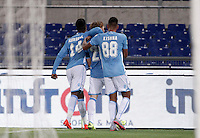 Calcio, Serie A: Lazio vs Bologna. Roma, stadio Olimpico, 22 agosto 2015.<br /> Lazio&rsquo;s Lucas Biglia, center, celebrates with teammates Keita Diao, left, and Ricardo Kishna after scoring during the Italian Serie A football match between Lazio and Bologna at Rome's Olympic stadium, 22 August 2015.<br /> UPDATE IMAGES PRESS/Isabella Bonotto