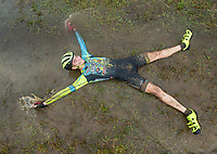 NWA Democrat-Gazette/BEN GOFF @NWABENGOFF<br /> Orion Child of Dogfish/Team Noah, splashes in a puddle after finishing in ninth place in the UCI Junior Men race Sunday, Oct. 6, 2019, during the the Fayettecross cyclocross races at Centennial Park at Millsap Mountain in Fayetteville.
