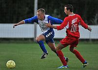 KSV Rumbeke - KSV De Ruiter : Davy Vanhecke aan de bal voor de trekkende Harold Cool (rechts)<br /> foto VDB / Bart Vandenbroucke