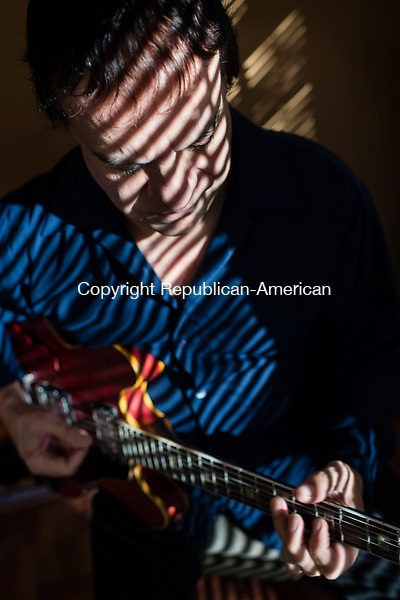 WATERBURY, CT- 19 October 2015-101915EC09-  Guitarist Tony Purrone practices at his Waterbury home. Erin Covey Republican-American